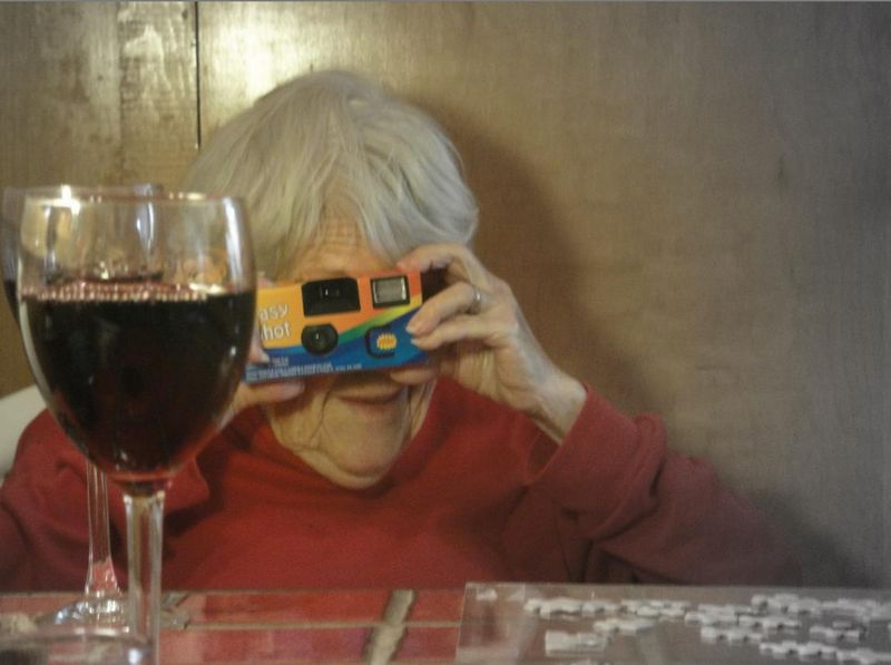 Mom, a camera and wine