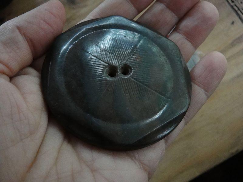 A big indigo button