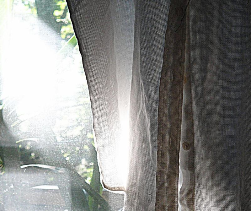 Dirty window and cloth in the morning light