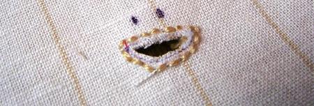 Mouth_shaped_eyelet